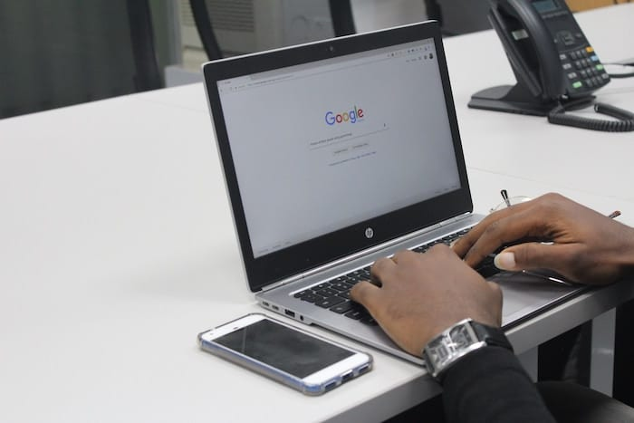 image of a person performing a google search